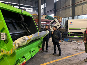 Customer from South Korea come to factory and study compactor waste equipment